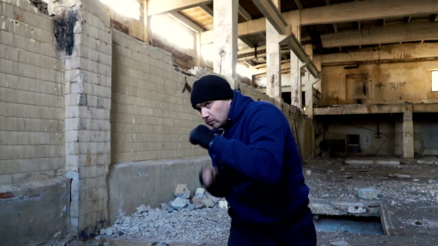 A boxer trains in an abandoned building. video