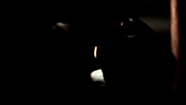 boxer works on his striking by hitting a punching bag. close up shot. - sacco per il pugilato video stock e b–roll