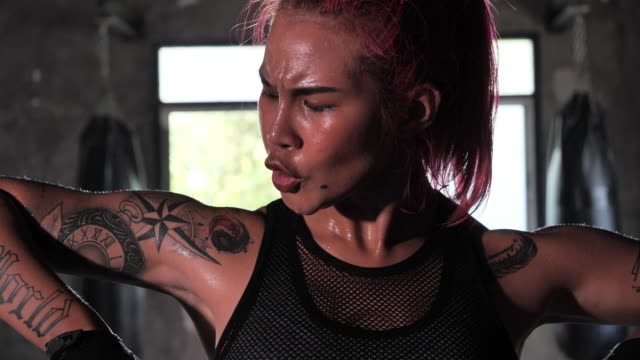 Boxers Asian women with tattoos of red hair, Female athletes training in the gym. Boxers Asian women with tattoos of red hair, Female athletes training in the gym. dyed red hair stock videos & royalty-free footage