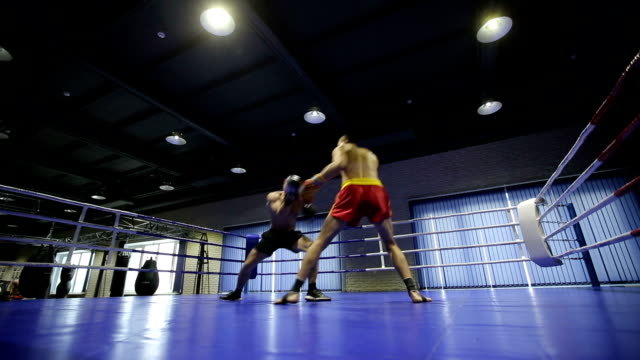 Boxers in the ring during fight video