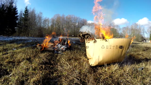 Boxes burning with organic rubbish, time lapse video