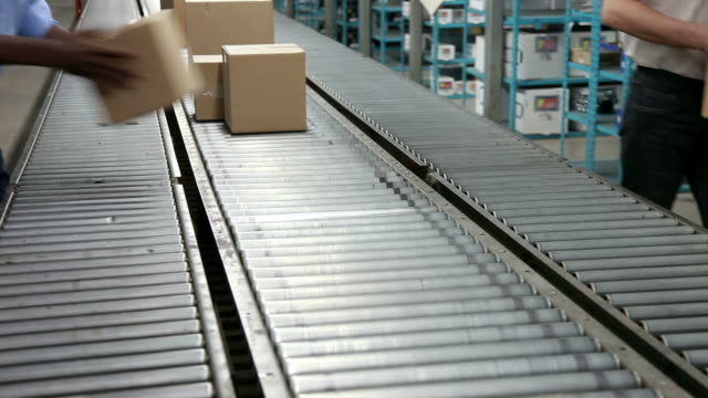 Boxes Coming Off a Conveyor Belt video