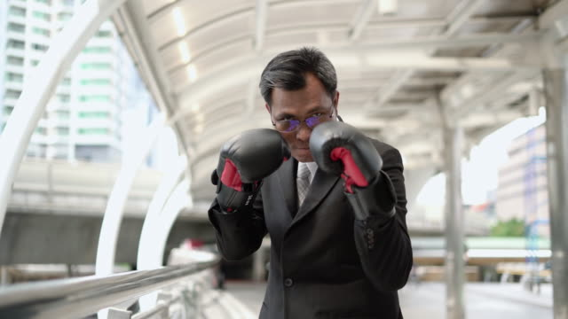 Boxing Businessman for concept of Competition business. Boxing Businessman for concept of Competition business. rivalry stock videos & royalty-free footage