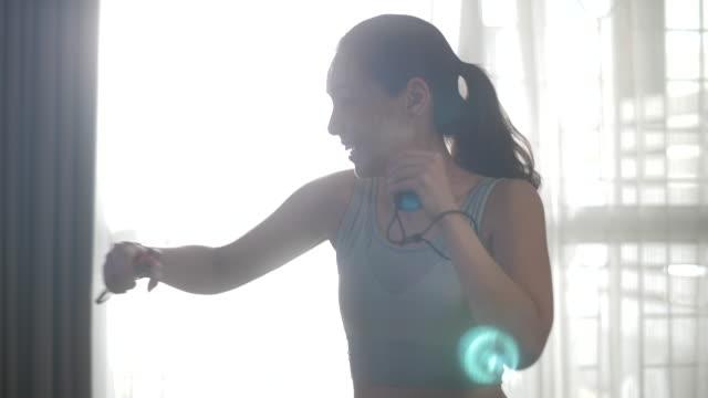 boxing exercise with video game - sacco per il pugilato video stock e b–roll
