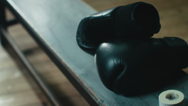 Boxing gloves lying on bench video