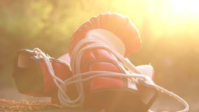 boxing gloves that are hung on the barbed wire - sacco per il pugilato video stock e b–roll