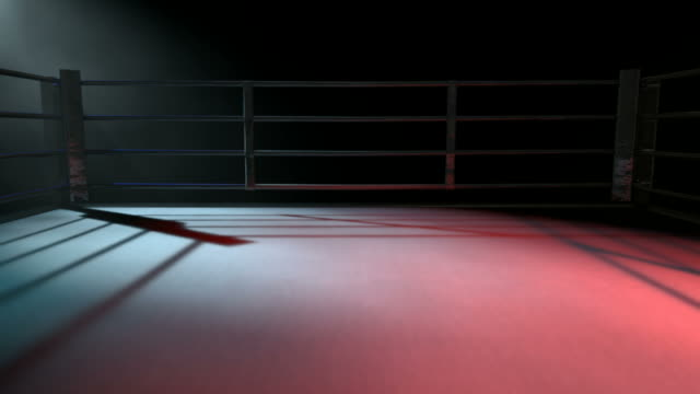boxing ring surrounded by ropes spotlit in either opposing corner - wrestling stock videos and b-roll footage