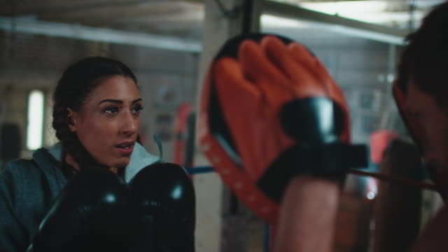 Boxing trainer teaches woman