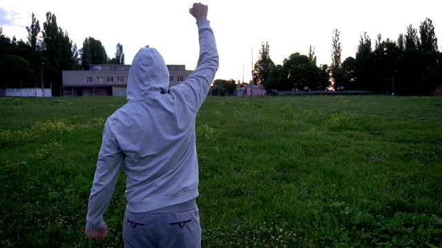 boxing training,boxing is a young man early in the morning at the stadium - allenamento con l'ombra video stock e b–roll