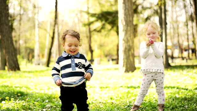 Boy and girl in the park. Slow motion video
