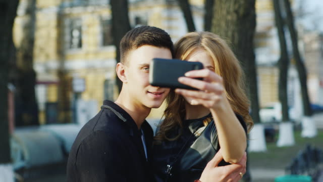 Boy and girl make selfie in the city video