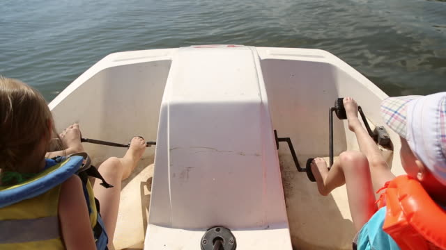 Boy and girl ride on a catamaran video
