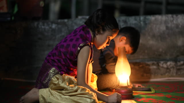 boy and girl studying in oil lamp - two students together asian video stock e b–roll