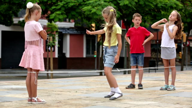 boy and girls in elementary school age having fun video