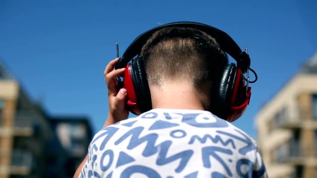 Boy and headphones Boy dancing with retro headphones. headphones stock videos & royalty-free footage