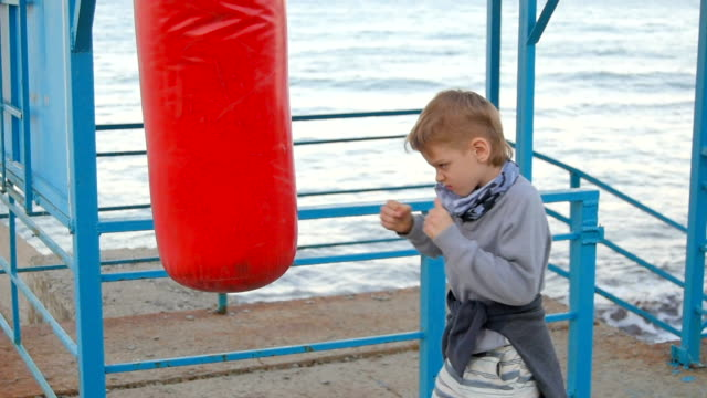 boy and punching bag video