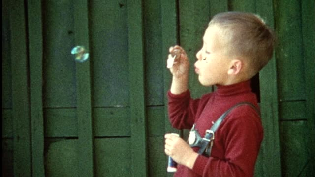 Boy blowing bubbles (vintage 8mm film) video