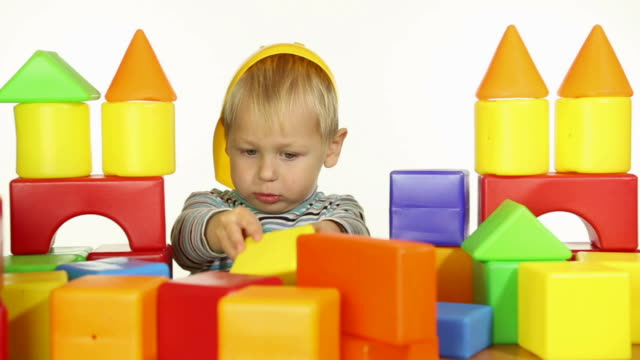 boy builds a house out of blocks video