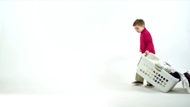 Boy Carries Laundry  laundry basket stock videos & royalty-free footage
