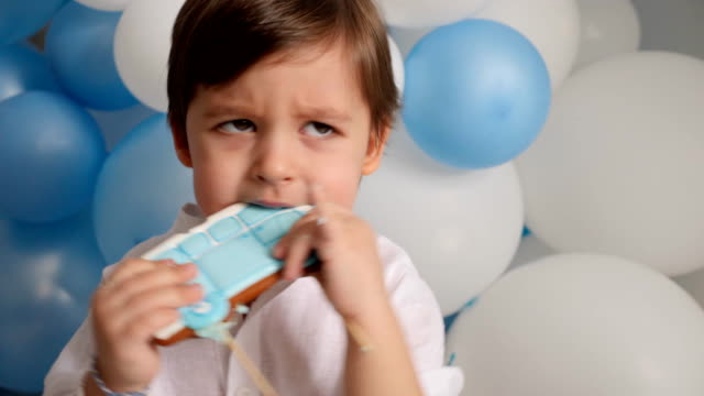boy child of two years eating a festive blue cake with a car - hippie fashion stock videos & royalty-free footage