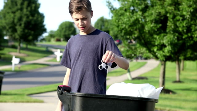 Boy Deciding To Throw Fidget Spinner In Trash video