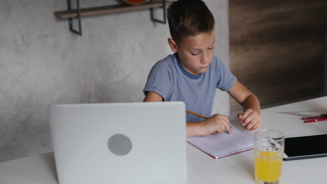 boy doing his homework - online learning stock videos & royalty-free footage