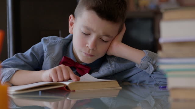 Boy doing his homework video