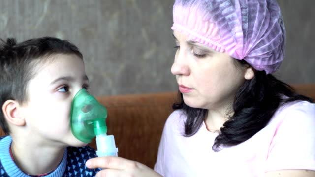 boy doing inhalation and nurse - flu shot стоковые видео и кадры b-roll