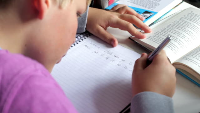 Boy Doing Written Homework In Bedroom video