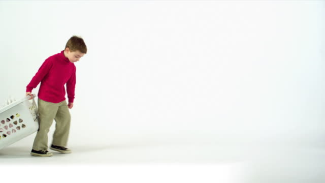 Boy Drags Laundry Basket  laundry basket stock videos & royalty-free footage
