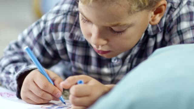 Boy Drawing Pictures with Markers video