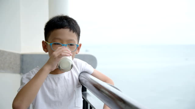 boy drinking a glass of milk video