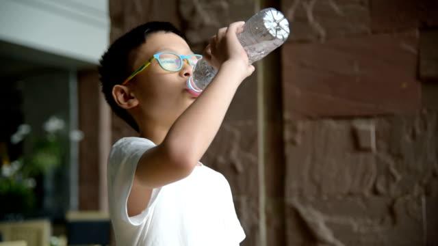 boy drinking water from bottle video