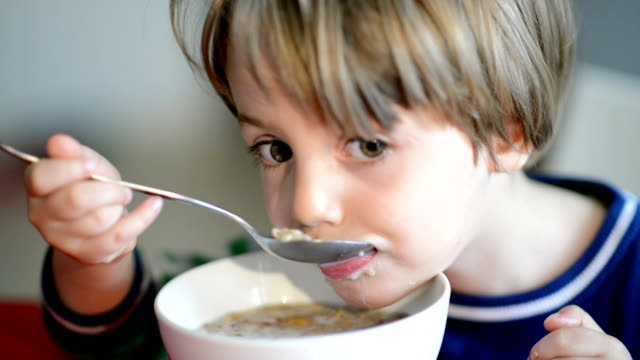 Boy Eating Cereal with Milk video