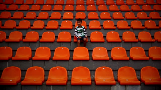boy enjoys the stadium that his team scored rivals, the boy is a fan of his team video