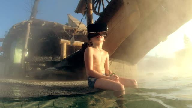 Boy Exploring virtual reality in geothermal pool
