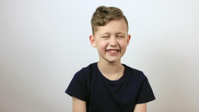 boy having fun and laughing. - solo bambini maschi video stock e b–roll