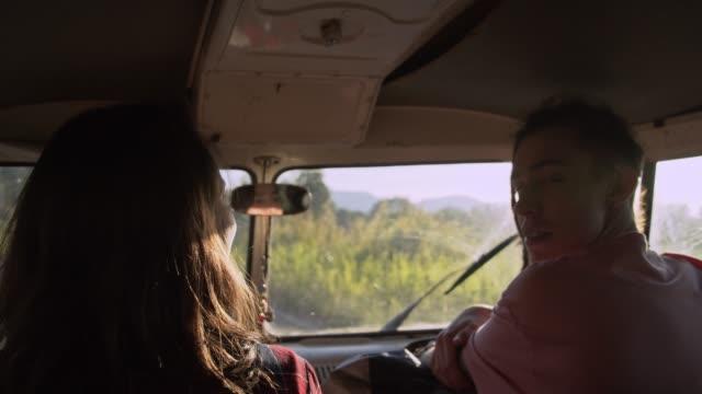 boy hitchhiking to girl