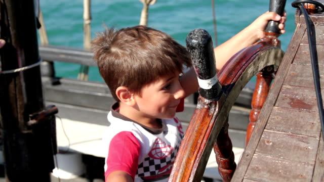 boy holding an steering wheel video
