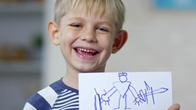 Boy Holding Picture and Smiling video