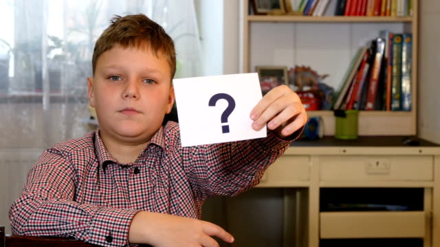 Boy Holding Question Mark video