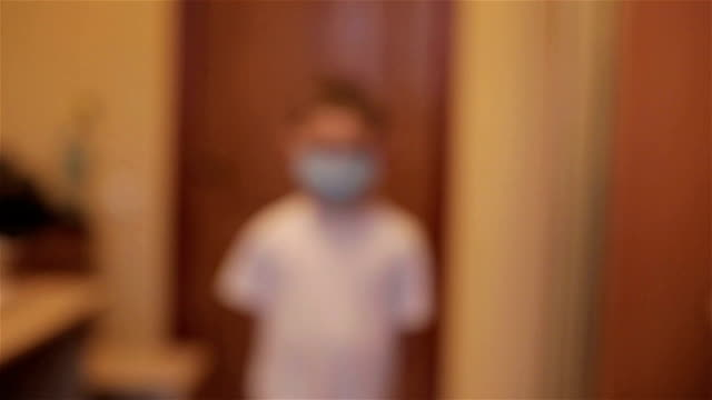 Boy in a mask suited to the doctor video