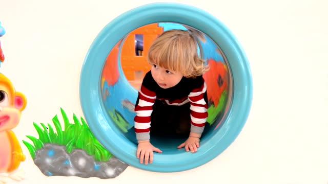 MONTAGE: A boy in playground video