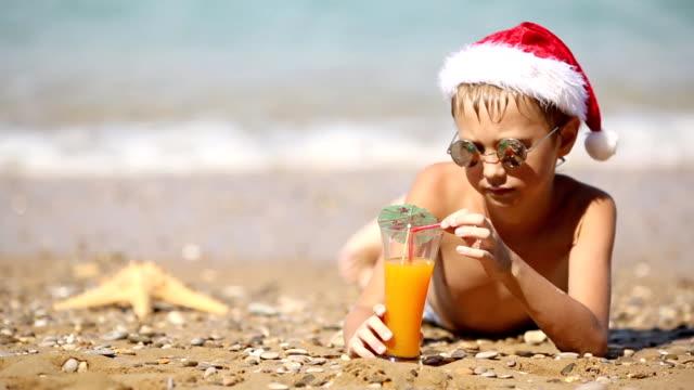 boy in Santa Claus hat