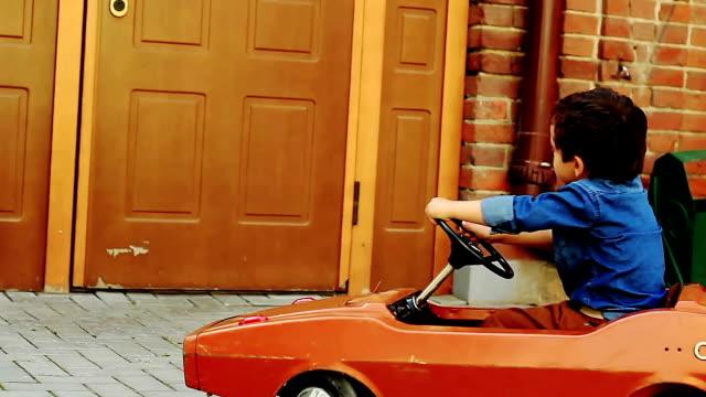 Boy in the children's car video