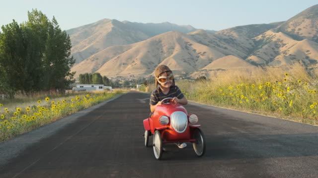 Boy in Toy Racing Car