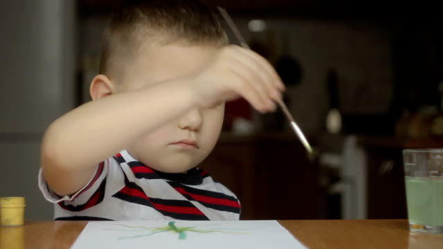 boy is going to draw paints and thunb up. nice background video