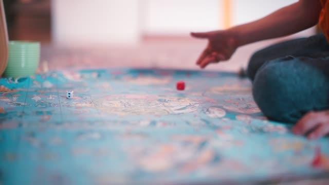 vídeos de stock, filmes e b-roll de um menino está jogando um jogo de tabuleiro. - game