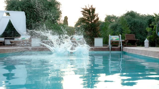 Boy jumping into swimming pool video