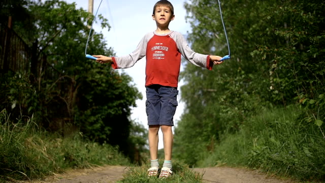 boy jumping rope outdoors video